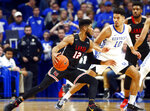 Lamar's V.J. Holmes (12) looks for an opening against Kentucky's Johnny Juzang (10) during the first half of an NCAA college basketball game in Lexington, Ky., Sunday, Nov. 24, 2019. (AP Photo/James Crisp)