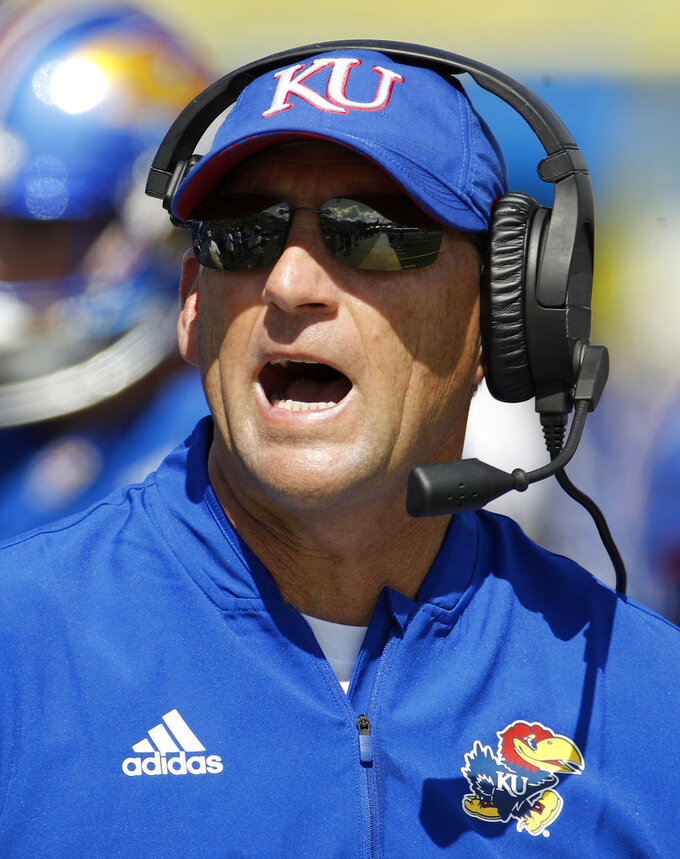 FILE - In this Sept. 15, 2018, file photo, Kansas head coach David Beaty talks to his players during the second half of an NCAA college football game against Rutgers, in Lawrence, Kan. Kansas plays at Texas Tech on Saturday, Oct. 20. (AP Photo/Charlie Riedel, File)