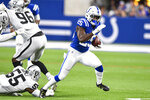 Indianapolis Colts running back Marlon Mack (25) breaks way from Oakland Raiders outside linebacker Vontaze Burfict (55) during the first half of an NFL football game in Indianapolis, Sunday, Sept. 29, 2019. (AP Photo/Doug McSchooler)