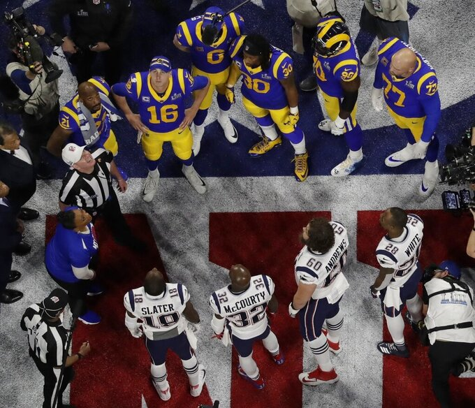Referee John Parry and players watch the coin toss before the NFL Super Bowl 53 football game between the Los Angeles Rams and the New England Patriots Sunday, Feb. 3, 2019, in Atlanta. (AP Photo/Morry Gash)