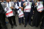 Members of the Turkish-Arab journalist association hold posters with photos of missing Saudi writer Jamal Khashoggi, as they hold a protest near the Saudi Arabia consulate in Istanbul, Monday, Oct. 8, 2018. Khashoggi, 59, went missing on Oct 2 while on a visit to the consulate in Istanbul for paperwork to marry his Turkish fiancée. The consulate insists the writer left its premises, contradicting Turkish officials. He had been living since last year in the U.S. in a self-imposed exile, in part due to the rise of Prince Mohammed, the son of King Salman. (AP Photo/Lefteris Pitarakis)