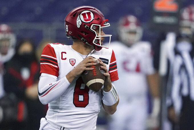 Utah quarterback Jake Bentley drops to pass against Washington during the first half of an NCAA college football game Saturday, Nov. 28, 2020, in Seattle. (AP Photo/Ted S. Warren)
