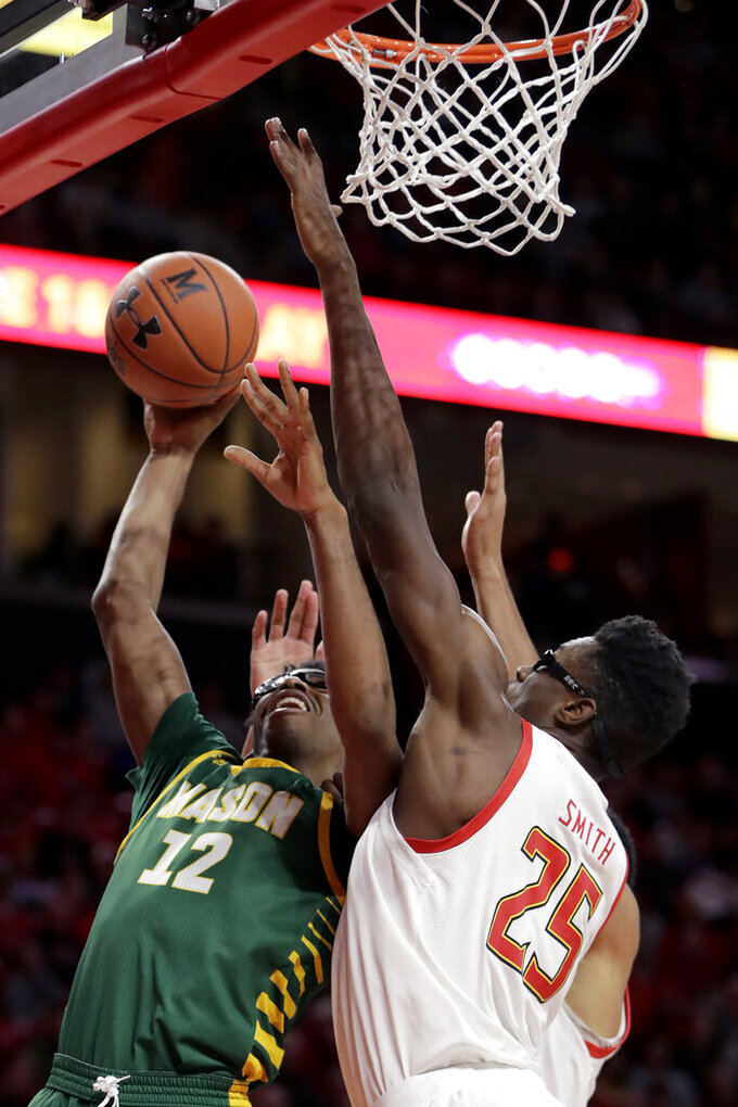 George Mason forward AJ Wilson (12) goes up for a shot against Maryland forward Jalen Smith (25) during the first half of an NCAA college basketball game Friday, Nov. 22, 2019, in College Park, Md. (AP Photo/Julio Cortez)