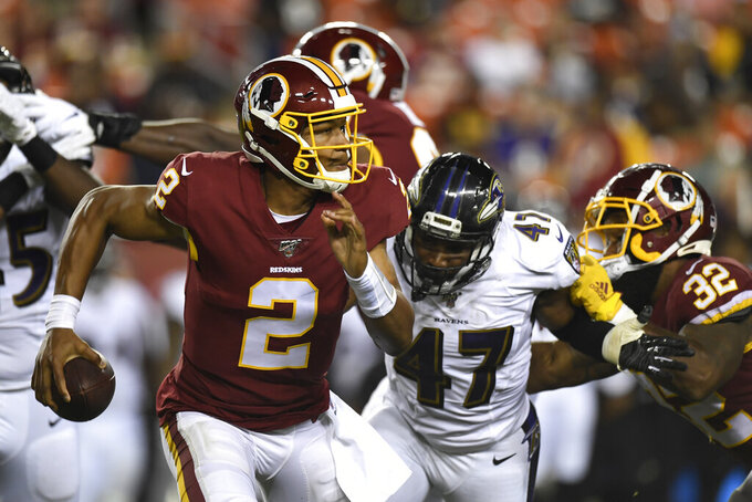 Washington Redskins quarterback Jalan McClendon (2) scrambles as he is pressured by Baltimore Ravens inside linebacker Donald Payne (47) during the second half of an NFL preseason football game at FedEx Field in Landover, Md., Thursday, Aug. 29, 2019. (AP Photo/Susan Walsh)