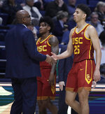 Southern California's Bennie Boatwright, right, is congratulated by assistant coach Eric Mobley in the second half of an NCAA college basketball game against California, Saturday, Feb. 16, 2019, in Berkeley, Calif. (AP Photo/Ben Margot)