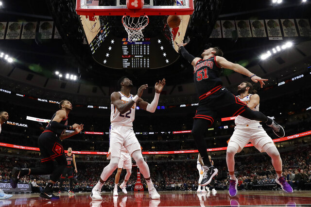 Chicago Bulls guard Ryan Arcidacono (51) shoots against the Phoenix Suns during the first half of an NBA basketball game in Chicago, Saturday, Feb. 22, 2020. (AP Photo/Nam Y. Huh)