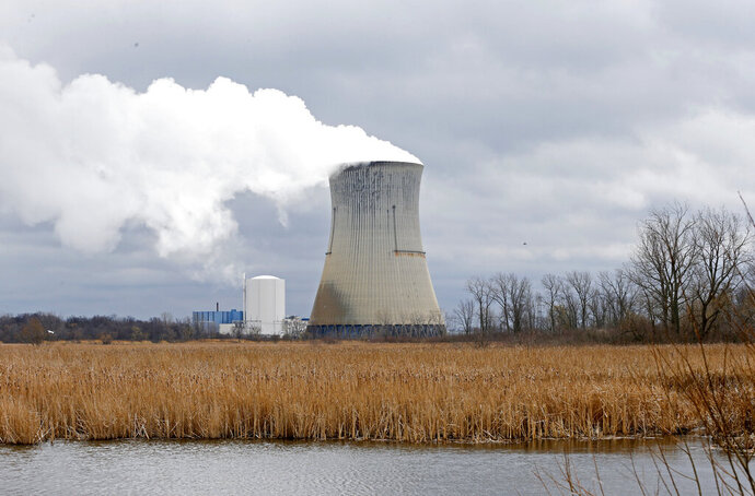 FILE – This April 4, 2017, file photo shows the entrance to FirstEnergy Corp.'s Davis-Besse Nuclear Power Station in Oak Harbor, Ohio. Ohio's attorney general has filed a lawsuit attempting to block the state's nuclear plants from collecting fees on electricity bills that were authorized in a new law. Attorney General Dave Yost filed the lawsuit Wednesday, Sept. 23, 2020 in Franklin County Court against Energy Harbor. (AP Photo/Ron Schwane, file)