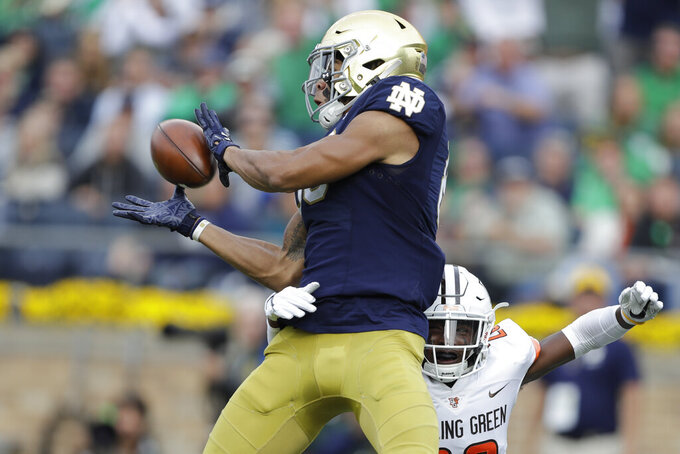 Notre Dame wide receiver Chase Claypool, left, makes a touchdown reception against Bowling Green defensive back JaJuan Hudson, right, during the first half of an NCAA college football game, Saturday, Oct. 5, 2019, in South Bend, Ind. (AP Photo/Darron Cummings)