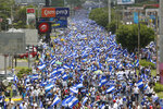 FILE- In this June 30, 2018 file photo, hundreds of thousands participate in a demonstration called the