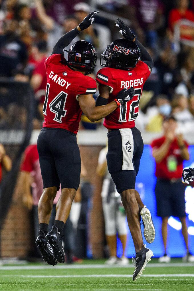 Northern Illinois cornerbacks Eric Rogers (12) and Jordan Gandy (14) celebrate during the first half of an NCAA college football game against Georgia Tech, Saturday, Sept. 4, 2021, in Atlanta. (AP Photo/Danny Karnik)