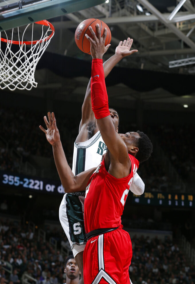 Michigan State's Aaron Henry, rear, blocks a shot by Ohio State's Andre Wesson during the first half of an NCAA college basketball game, Sunday, March 8, 2020, in East Lansing, Mich. (AP Photo/Al Goldis)
