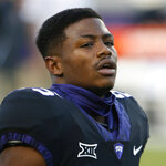 FILE - In this Nov. 4, 2017, file photo, TCU wide receiver KaVontae Turpin (25) warms up before playing Texas in an NCAA college football game, in Fort Worth, Texas. TCU receiver and standout returner KaVontae Turpin has been dismissed from the team after a second similar charge surfaced following his weekend arrest on an assault charge for an alleged altercation with his girlfriend. Coach Gary Patterson said Tuesday, Oct. 23, 2018, that Turpin will no longer be allowed to be on the team.(AP Photo/Ron Jenkins, File)