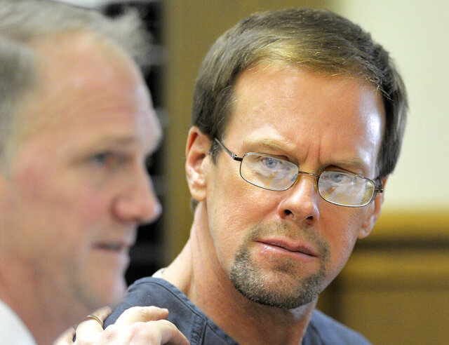 FILE - In this Jan. 6, 2016, file photo, Mark Jensen looks at his attorney, Craig Albee, during a bond hearing in Kenosha, Wis. On Wednesday, Feb. 26, 2020, the Kenosha News reported, the Wisconsin Court of Appeals ordered a new trial for Jensen, a man convicted in the 1998 poisoning death of his wife, ruling that a lower court judge erred in 2017 when he reinstated Jensen's conviction.   (Sean Krajacic/The Kenosha News via AP, File)