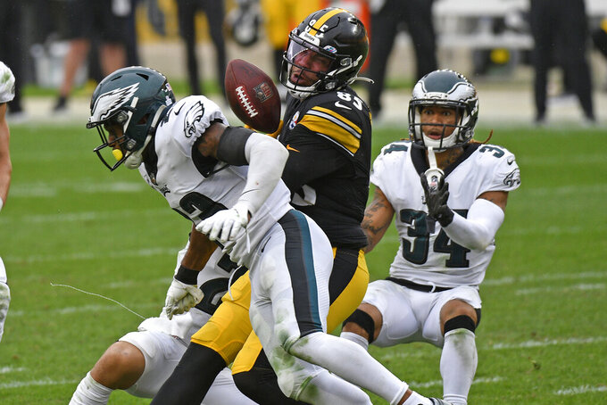 Pittsburgh Steelers tight end Eric Ebron (85) fumbles the ball as he is hit by Philadelphia Eagles free safety Rodney McLeod (23) during the second half of an NFL football game in Pittsburgh, Sunday, Oct. 11, 2020. The Eagles recovered the fumble. (AP Photo/Don Wright)