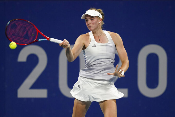 Elena Rybakina, of Kazakhstan, returns to Donna Vekic, of Croatia, during the third round of the women's tennis competition at the 2020 Summer Olympics, Tuesday, July 27, 2021, in Tokyo, Japan. (AP Photo/Patrick Semansky)