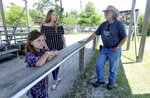 New videographer Rick Stalker talks with Kayla Costanzo of Bridge City as her daughter Braelynn watches Big Al at Gator Country in Fannett, Texas Monday, May 11, 2020. Gator Country reopened the first weekend in May after being closed for weeks amid COVID-19 restrictions. (Kim Brent/The Beaumont Enterprise via AP)