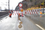 A road barrier at he main street in Zell am See, Austrian province of Salzburg, on Monday, Nov. 18, 2019. The extreme snow and rainfalls of the past few days cause massive dangers and disabilities in parts of Austria,(AP Photo/Kerstin Joensson)