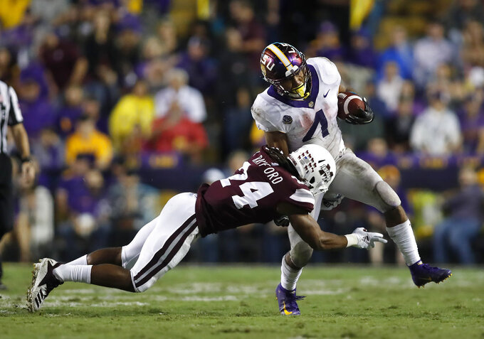 LSU running back Nick Brossette (4) is tackled by Mississippi State defensive end Gerri Green (4) during an NCAA college football game in Baton Rouge, La., Saturday, Oct. 20, 2018. LSU won 19-3. (AP Photo/Tyler Kaufman)