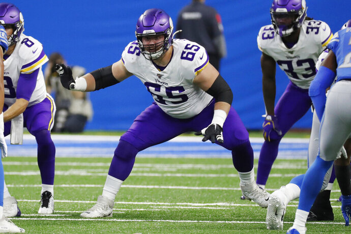 FILE - In this Oct. 20, 2019, file photo, Minnesota Vikings guard Pat Elflein (65) sets up to block during the first half of the team's NFL football game against the Detroit Lions in Detroit. The Vikings have placed starting right guard Elflein on injured reserve. The fourth-year player will miss at least three games. The Vikings did not disclose the injury for Elflein, who has not appeared on the injury report this season. (AP Photo/Rick Osentoski, File)