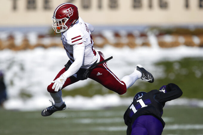 Massachusetts' Cam Roberson, left, is hit by Northwestern's A.J. Hampton during the first half of an NCAA college football game Saturday, Nov. 16, 2019, in Evanston, Ill. (AP Photo/Jim Young)