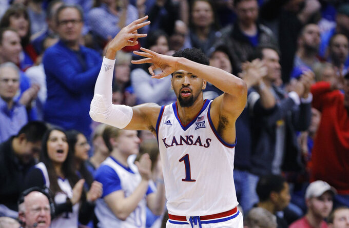 Kansas forward Dedric Lawson (1) reacts after hitting a three-point shot during the second half of an NCAA college basketball game against Texas Christian, Wednesday, Jan. 9, 2019, in Lawrence, Kan. Lawson scored 31 points in the the Jayhawks ' 77-68 win over the Horned Frogs. (AP Photo/Colin E. Braley)