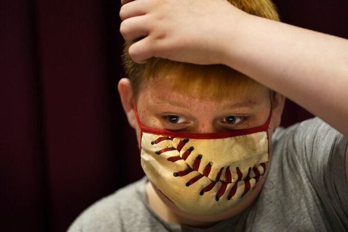 Jacob Conary, 15, prepares himself for his first shot of the COVID-19 vaccination, Wednesday, May 12, 2021, in Auburn, Maine. Vaccination clinics in Maine recently opened up to 12 to 15-year-olds. (AP Photo/Robert F. Bukaty)