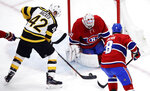 Boston Bruins right wing David Backes (42) shoots on Montreal Canadiens goaltender Carey Price, center, during the first period of an NHL hockey game in Boston, Monday, Jan. 14, 2019. At right is Montreal Canadiens defenseman Jordie Benn (8). (AP Photo/Charles Krupa)
