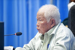 In this photo released by the Extraordinary Chambers in the Courts of Cambodia, Khieu Samphan, former Khmer Rouge head of state, gives a speech in a courtroom during a hearing at the U.N.-backed war crimes tribunal in Phnom Penh, Cambodia, Thursday, Aug. 19, 2021. The last living member of former Cambodian leader Pol Pot's inner circle denied complicity in the genocide committed under the brutal Khmer Rouge government, telling an international tribunal hearing his appeal Thursday that he was being judged as a proxy for the entire radical communist regime. (Mark Peters/Extraordinary Chambers in the Courts of Cambodia via AP)