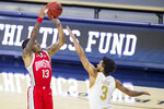 Ohio State's CJ Walker (13) shoots over Notre Dame's Prentiss Hubb (3) during the first half of an NCAA college basketball game Tuesday, Dec. 8, 2020, in South Bend, Ind. Ohio State won 90-85. (AP Photo/Robert Franklin)