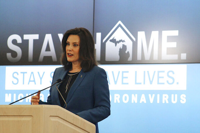 "FILE - In this this April 22, 2020, file photo, provided by the Michigan Office of the Governor, Michigan Gov. Gretchen Whitmer addresses the state during a speech in Lansing, Mich. The ""veepstakes"" competition that unfolds every four years is one of the most unpredictable, often awkward, rituals of politics. That's especially true this time as the pandemic has overtaken the presidential campaign, forcing those thought to be in the running for the No. 2 spot to be even more creative in getting noticed. Whitmer wore a T-shirt on television emblazoned with the words ""that woman from Michigan,"" a cheeky reference to President Donald Trump's dismissal of her.  (Michigan Office of the Governor via AP, Pool)"