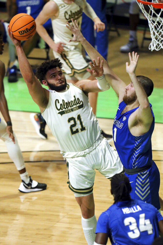 Colorado State guard David Roddy (21) shoots against Buffalo center Brock Bertram (41) during the first half of an NCAA college basketball game in the NIT, Friday, March 19, 2021, in Denton, Texas. (AP Photo/Richard W. Rodriguez)