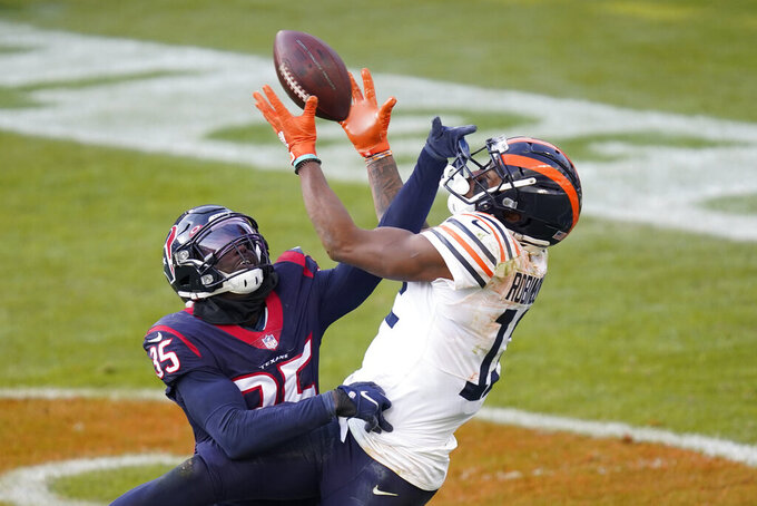 Houston Texans' Keion Crossen (35) breaks up a pass intended by Chicago Bears' Allen Robinson (12) during the second half of an NFL football game, Sunday, Dec. 13, 2020, in Chicago. (AP Photo/Charles Rex Arbogast)