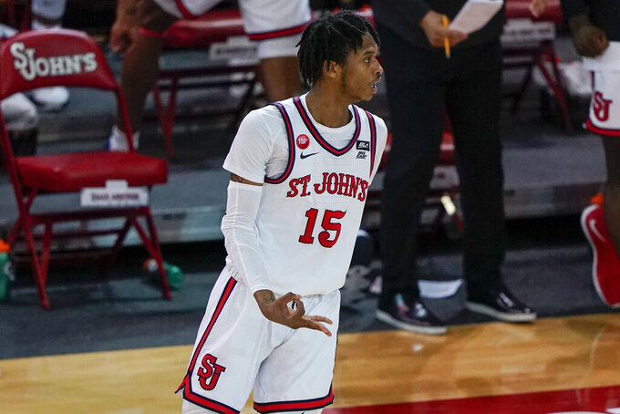 St. John'sVince Cole (15) gestures after making a three point basket during the second half of an NCAA college basketball game against Villanova Wednesday, Feb. 3, 2021, in New York. (AP Photo/Frank Franklin II)