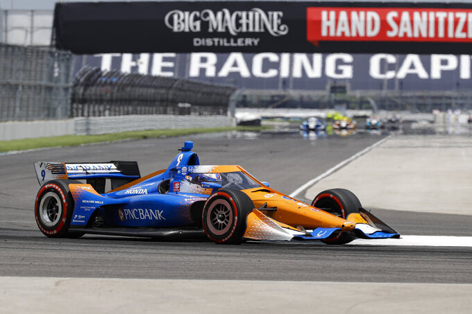 Race driver Scott Dixon, of New Zealand, drives through a turn during the IndyCar auto race at Indianapolis Motor Speedway in Indianapolis, Saturday, July 4, 2020. (AP Photo/Darron Cummings)
