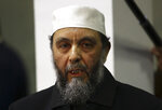 Abdallah Djaballah, president of Algeria's Justice and Development Front, an Islamist party, attends a political opposition meeting in Algiers, Wednesday, Feb.20, 2019. Sectors of Algeria's diverse political opposition are meeting Wednesday to secure a joint candidate to face incumbent President Abdelaziz Bouteflika in the April 18 presidential election. (AP Photo/Anis Belghoul)