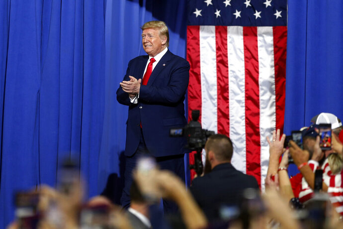 President Donald Trump arrives at a campaign rally Thursday, Oct. 10, 2019, in Minneapolis. (AP Photo/Jim Mone)