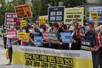 South Korean protesters shout slogans during a protest over the death of George Floyd, a black man who died after being restrained by Minneapolis police officers on May 25, near the U.S. embassy in Seoul, South Korea, Friday, June 5, 2020. The signs read: