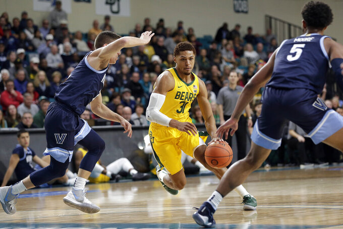 Baylor guard MaCio Teague (31) drives between Villanova guards Collin Gillespie, left, and Justin Moore (5) during the first half of an NCAA college basketball championship game at the Myrtle Beach Invitational in Conway, S.C., Sunday, Nov. 24, 2019. (AP Photo/Gerry Broome)