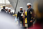 USS Cole sailors read the names of the 17 sailors killed in the attack during a roll call of heroes of a remembrance ceremony commentating the 20th anniversary of the attack on USS Cole at Naval Station Norfolk on Monday, Oct. 12, 2020. (Jonathon Gruenke/The Virginian-Pilot via AP)