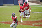 Mississippi quarterback Matt Corral (2) looks downfield for an open man to pass to during the second half of an NCAA college football game against Auburn in Oxford, Miss., Saturday Oct. 24, 2020. (AP Photo/Rogelio V. Solis)