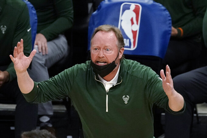 FILE - In this Feb. 18, 2021, file photo, Milwaukee Bucks coach Mike Budenholzer reacts to a call during the second half of the team's NBA basketball game against the Toronto Raptors in Milwaukee. Budenholzer has received a contract extension after guiding the team to its first NBA title in a half century. The Bucks announced Tuesday night, Aug. 24, they had signed Budenholzer to an extension. Details weren't disclosed. (AP Photo/Morry Gash, File)