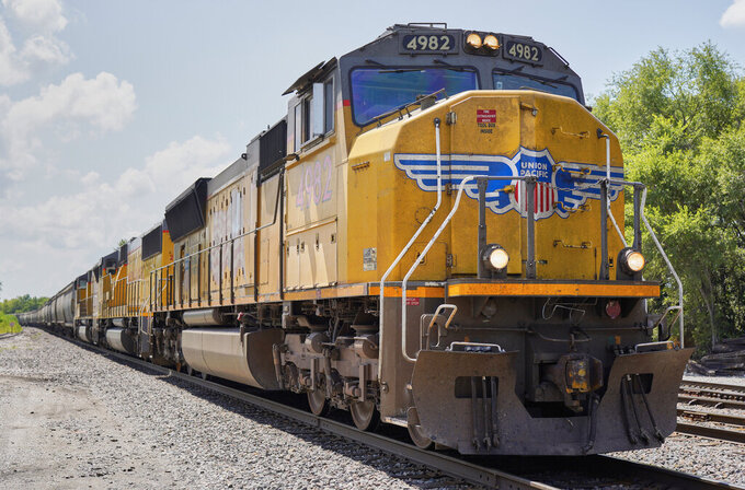 FILE - In this July 31, 2018, file photo a Union Pacific train travels through Union, Neb.   Union Pacific's first-quarter profit declined 9% as the railroad delivered less freight and its revenue fell. The Omaha, Nebraska-based company said Thursday, April 22, 2021,  that it earned $1.34 billion, or $2 per share, in the quarter.  (AP Photo/Nati Harnik, File)