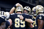 New Orleans Saints quarterback Drew Brees (9) celebrates his touchdown pass to tight end Josh Hill (89), which broke the NFL record for career touchdown passes, surpassing Peyton Manning, in the second half of an NFL football game against the Indianapolis Colts in New Orleans, Monday, Dec. 16, 2019. (AP Photo/Butch Dill)