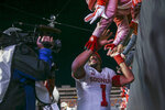 Oklahoma quarterback Jalen Hurts (1) greets fans after his team's 34-16 win over Oklahoma State in an NCAA college football game, Saturday, Nov. 30, 2019, in Stillwater, Okla. (Ian Maule/Tulsa World via AP)
