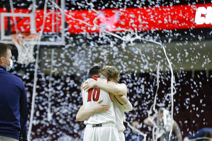 Eastern Washington's Jacob Davison (10) and Jack Perry celebrate the team's 65-55 win over Montana State in an NCAA college basketball game for the championship of the Big Sky men's tournament in Boise, Idaho, Saturday, March 13, 2021. (AP Photo/Otto Kitsinger)