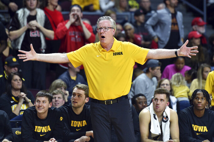 Iowa coach Fran McCaffery reacts to a call during the second half of an NCAA college basketball game against San Diego State Friday, Nov. 29, 2019, in Las Vegas. (AP Photo/David Becker)