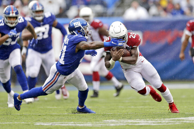 New York Giants' Antoine Bethea, left, tries to tackle Arizona Cardinals' Chase Edmonds during the first half of an NFL football game, Sunday, Oct. 20, 2019, in East Rutherford, N.J. (AP Photo/Adam Hunger)