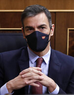 Spain's Prime Minister Pedro Sanchez takes part during a parliamentary session in Madrid, Spain, Wednesday Oct. 21, 2020. Spanish Prime Minister Pedro Sanchez faces a no confidence vote in Parliament put forth by the far right opposition party VOX. (AP Photo/Manu Fernandez, Pool)