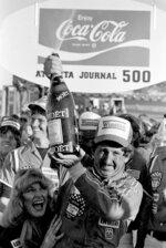 FILE - In this Nov. 8, 1981, file photo, driver Neil Bonnett, of Hueytown, Ala., sprays champagne in Victory Lane after winning the Atlanta Journal 500 auto race at Atlanta International Raceway in Hampton, Ga. Bonnett, a a popular member of the