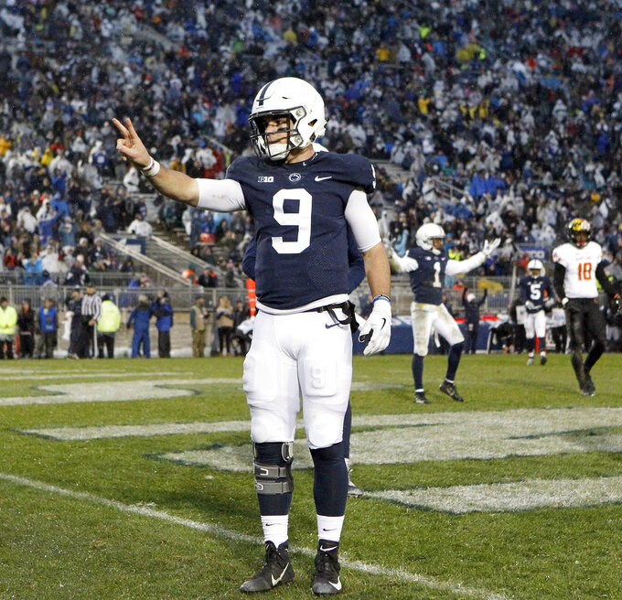 Penn State quarterback Trace McSorley (9) reacts after scoring his second rushing touchdown against Maryland during the first half of an NCAA college football game in State College, Pa., Saturday, Nov. 24, 2018. (AP Photo/Chris Knight)